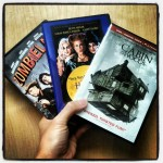 three handheld Halloween DVD's