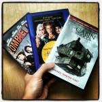 three handheld Halloween DVD's